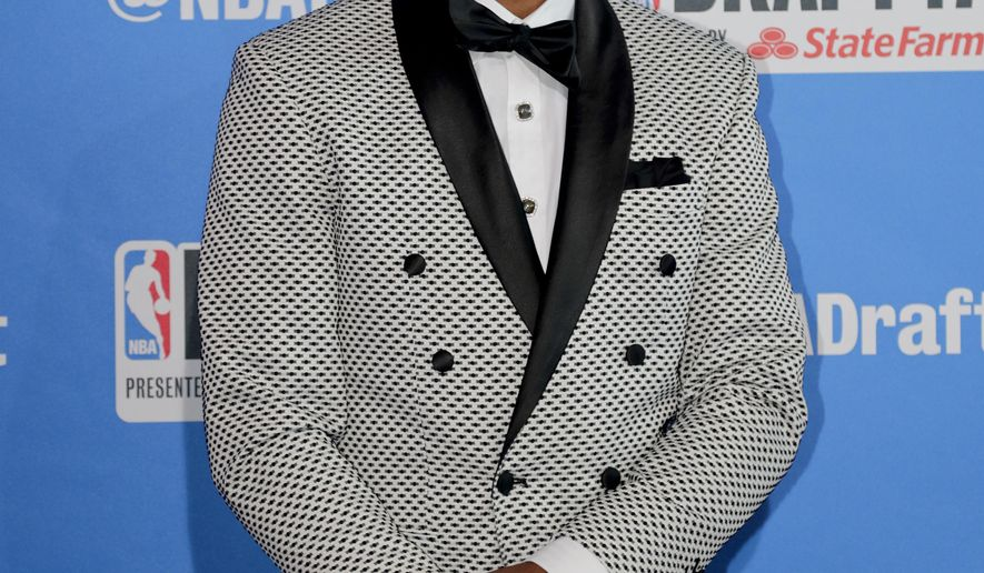 North Carolina State's Dennis Smith poses for photos while walking the red carpet before the start of the NBA basketball draft, Thursday, June 22, 2017, in New York. (AP Photo/Frank Franklin II)
