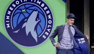 Lauri Markkanen reacts after being selected by the Minnesota Timberwolves as the seventh pick overall during the NBA basketball draft, Thursday, June 22, 2017, in New York. (AP Photo/Frank Franklin II)