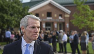 Sen. Rob Portman, R-Ohio, speaks to the press before the funeral of Otto Warmbier, Thursday, June 22, 2017, in Wyoming, Ohio. Warmbier, a 22-year-old University of Virginia undergraduate student who was sentenced in March 2016 to 15 years in prison with hard labor in North Korea, died this week, days after returning to the United States. (AP Photo/Bryan Woolston)