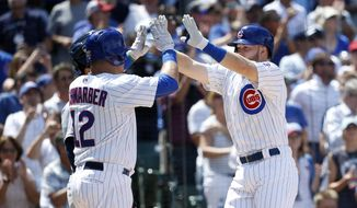 Chicago Cubs' Kyle Schwarber (12) and Ian Happ celebrate after they scored on Happ's home run during the fourth inning of a baseball game against the San Diego Padres Wednesday, June 21, 2017, in Chicago. (AP Photo/Charles Rex Arbogast)