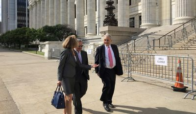 Carl Paladino, right, walks with his lawyers outside the state Department of Education building after the first day of testimony before Education Commissioner MaryEllen Elia, who will decide if Paladino should be removed from his position on the Buffalo Board of Education, Thursday, June 22, 2017, in Albany, N.Y. (AP Photo/Mary Esch)