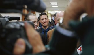 "David Daleiden, center, one of the two anti-abortion activists who released secretly recorded videos alleging that Planned Parenthood sold fetal tissue to researchers, addresses the media with attorneys Jared Woodfill, left, and Terry Yates after turning himself in to authorities in Houston. w judge should disqualify himself from a lawsuit over an anti-abortion group's videos says he could not readily discern any appearance of bias. U.S. District Court Judge James Donato said Thursday, June 22, 2017, he was having trouble understanding how Judge William Orrick's affiliation with a non-profit and two Facebook ""likes"" by Orrick's wife created an appearance of bias against defendant David Daleiden. (AP Photo/Bob Levey)"