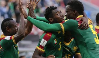 Cameroon's Andre Frank Zambo Anguissa, center, celebrates with teammate Vincent Aboubakar, right, after scoring his side's first goal during the Confederations Cup, Group B soccer match between Cameroon and Australia, at the St. Petersburg Stadium, Russia, Thursday, June 22, 2017. (AP Photo/Ivan Sekretarev)