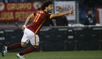 FILE - In this Monday, April 11, 2016 file photo, Roma's Mohammed Salah celebrates after scoring during their Serie A soccer match against Bologna, in Rome's Olympic stadium. Egypt winger Mohamed Salah will get another chance to prove himself in the English Premier League after sealing a move to Liverpool from Roma on Thursday, June 22, 2017. The 25-year-old Salah made just six league starts during his time playing for Chelsea from February 2014 to February 2015 before being sent on loan first to Fiorentina and then Roma. (AP Photo/Gregorio Borgia, file)