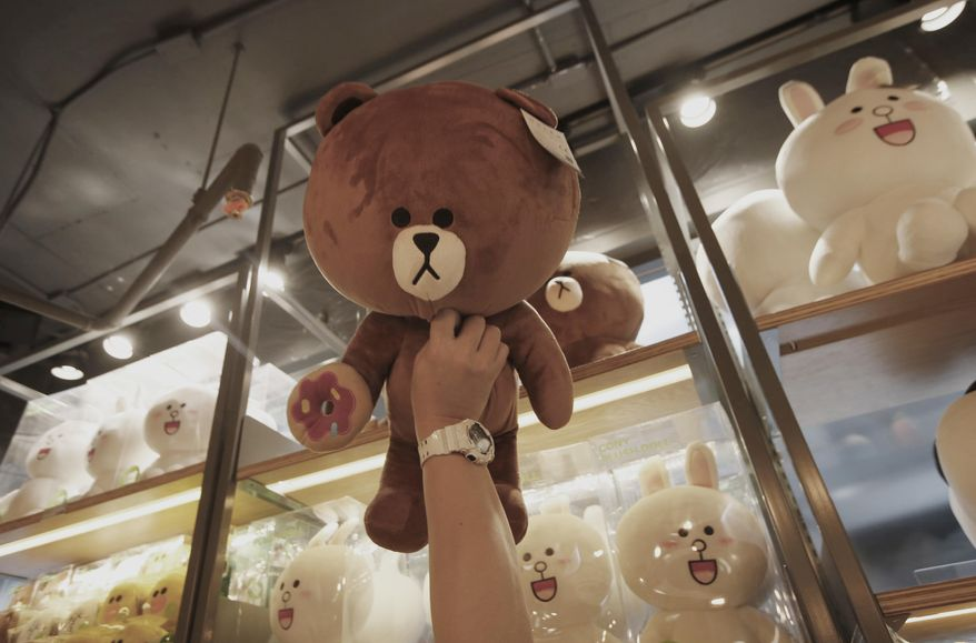 Thai customer selects merchandise at Line Village in Bangkok, Thailand, Thursday, June 22, 2017. Thailand's most popular text-messaging service will open its doors to the public Friday with an extravagant digital theme park called Line Village Bangkok. (AP Photo/Sakchai Lalit)