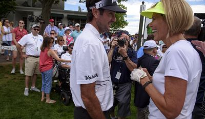 Bubba Watson and Connecticut basketball assistant coach Chris Dailey talk at the Travelers Championship at TPC River Highlands, Wednesday, June 21, 2017 in Cromwell, Conn. (Mark Mirko/Hartford Courant via AP)