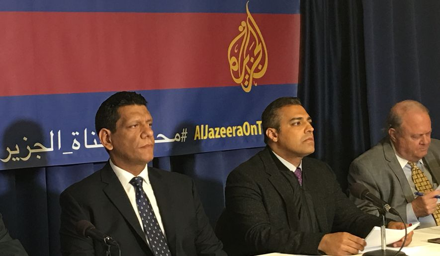 Former Al Jazeera journalists Mohamed Fawzi (let) and Mohamed Fahmy speak at a press conference in Washington, D.C., on Thursday about their lawsuit against Al Jazeera, charging the network with negligence, breach of contract and misrepresentation. (Laura Kelly/The Washington Times)