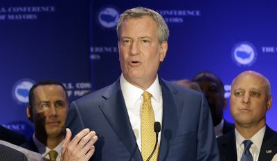 New York City Mayor Bill de Blasio talks to reporters during a news conference at the U.S. Mayors Conference, Friday, June 23, 2017, in Miami Beach, Fla. The U.S. (AP Photo/Alan Diaz) ** FILE **