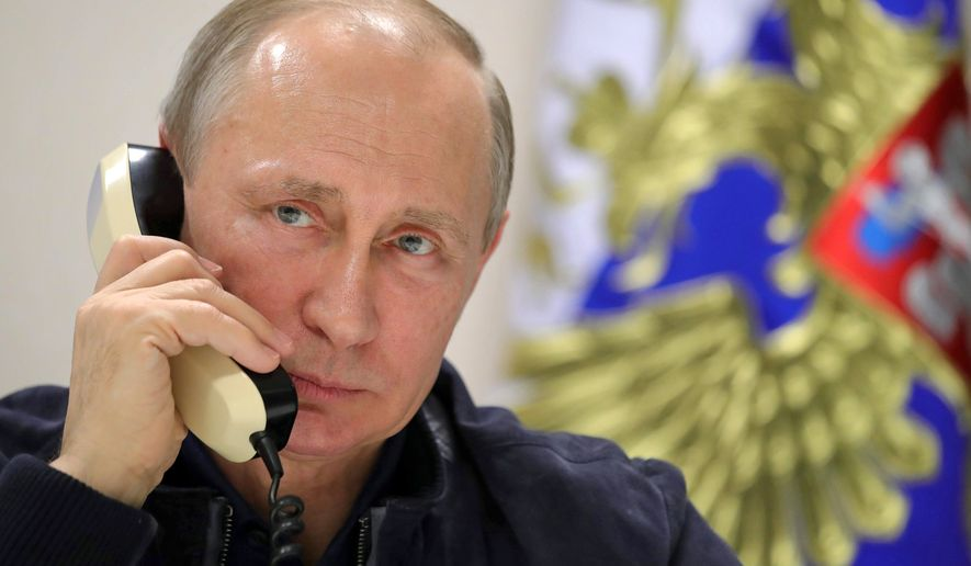 Russian President Vladimir Putin speaks over the phone with Turkish President Recep Tayyip Erdogan aboard the pipelaying vessel Pioneering Spirit in the Black Sea near Anapa, Russia, Friday, June 23, 2017. The president has inspected the work on the Turkish Stream gas pipeline project. (Mikhail Klimentyev/Sputnik, Kremlin Pool Photo via AP)