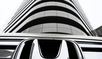 File-This Feb. 10, 2010, file photo shows Honda Motor Co.'s vehicle on display in front of the automaker's headquarters in Tokyo, Japan.  Honda is going public in an effort to debunk claims by lawyers that it knew about the hazards of exploding Takata air bag inflators nearly two decades ago but covered them up. The automaker issued a statement Friday, June 23, 2017, that outlines its defense against claims that Honda should compensate car owners because the use of Takata air bags caused their vehicles to lose value. (AP Photo/Shizuo Kambayashi, File)
