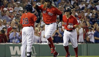 Boston Red Sox designated hitter Hanley Ramirez, middle, celebrates with Jackie Bradley Jr. (19) after hitting a two-run home run that scored Andrew Benintendi, right, against the Los Angeles Angels during the fourth inning of a baseball game at Fenway Park, Friday, June 23, 2017, in Boston. (AP Photo/Elise Amendola)