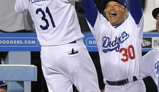 Los Angeles Dodgers' Joc Pederson, left, is congratulated by manager Dave Roberts after hitting a solo home run during the seventh inning of the team's baseball game against the New York Mets, Thursday, June 22, 2017, in Los Angeles. (AP Photo/Mark J. Terrill)