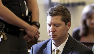 Former University of Cincinnati police officer Raymond Tensing listens as Hamilton County Common Pleas Judge Leslie Ghiz tells the jury to continue deliberations  after the jury said they are deadlocked during Tensing's trial on Friday, June 23, 2017 in Cincinnati.  Tensing is charged with murder and voluntary manslaughter in the shooting of unarmed black motorist Sam DuBose during a 2015 traffic stop. (Cara Owsley /The Cincinnati Enquirer via AP, Pool)