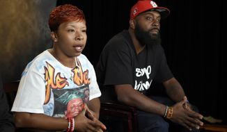 In this Sept. 27, 2014, file photo, the parents of Michael Brown, Lezley McSpadden, left, and Michael Brown Sr., sit for an interview with The Associated Press in Washington. The city attorney in Ferguson, Missouri, said Friday, June 23, 2017, that the city's insurance company paid $1.5 million to settle a lawsuit filed by the family of Michael Brown. (AP Photo/Susan Walsh, File)