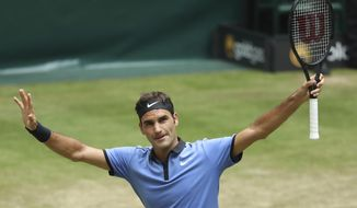 Switzerland's Roger Federer celebrates after beating Germany's Florian Mayer in the quarterfinal of the ATP tournament in Halle, Germany, Friday, June 23, 2017. (Friso Gentsch/dpa via AP)