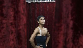 In this June 12, 2017 photo, 15-year-old ballet dancer Amiruddin Shah waits before a performance in Mumbai, India. The teenage son of a welder from a Mumbai slum has won a spot at the prestigious American Ballet Theatre's Jacqueline Kennedy Onassis School in New York. Shah was doing backflips and contemporary dance when his Israeli-American instructor first discovered his talent. Now, he's trying to raise funds to cover his training in the US. (AP Photo/Rajanish Kakade)
