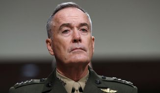 Marine Corps Gen. Joseph Dunford, chairman of the Joint Chiefs of Staff chairman, said he would wait for a formal edict from the White House on whether transgender people can serve in the military. (Associated Press)