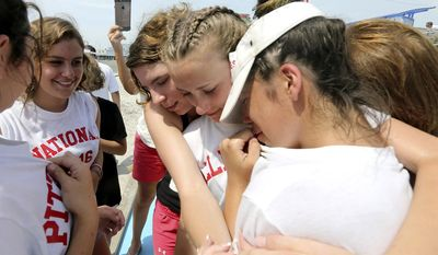 Sierra Ricci, center, of Allegheny County Pa., is surrounded by friends and family after winning the girls National Marbles Championship in Wildwood, N.J., Thursday June 22, 2017, (Dale Gerhard/The Press of Atlantic City via AP)