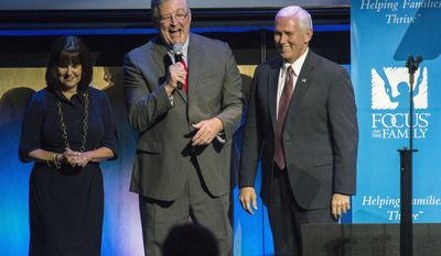 Focus on the Family President Jim Daly, center, jokes with Vice President Mike Pence and his wife, Karen, while introducing them at the organization's 40th anniversary celebration Friday, June 23, 2017, during his visit to Colorado Springs, Colo. (Christian Murdock /The Gazette via AP, Pool)