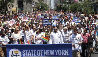 FILE- In this June 26, 2016 file photo, marchers filled the street during New York City's pride parade. The annual pride parade takes place on Sunday, June 25, 2017, amid protests by black and brown LGBT people saying increasingly corporate pride celebrations prioritize the experiences of gay white men and ignore the issues continuing to face black and brown LGBT people. (AP Photo/Mel Evans, File)