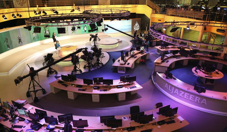 In this Jan. 1, 2015, file photo, staff members of Al-Jazeera International work at the news studio in Doha, Qatar. Kuwait has given Qatar a list of demands from Saudi Arabia and other Arab nations that includes shutting down Al-Jazeera and cutting diplomatic ties to Iran. (AP Photo/Osama Faisal, File)