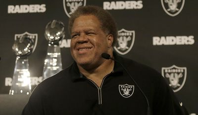 Oakland Raiders general manager Reggie McKenzie smiles while speaking at a news conference in Oakland, Calif., Friday, June 23, 2017. Raiders quarterback Derek Carr finalized a five-year contract extension that will keep him with the team through the 2022 season. (AP Photo/Jeff Chiu)