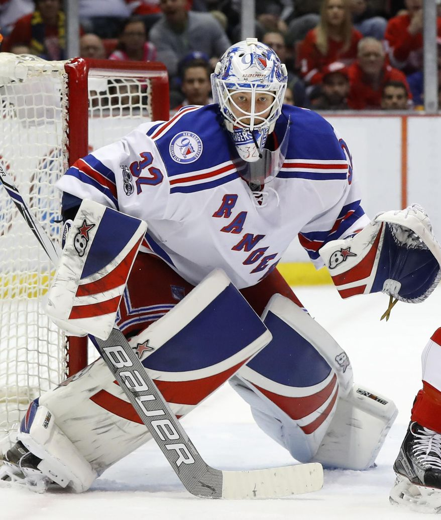 FILE - In this March 12, 2017, file photo, New York Rangers goalie Antti Raanta (32) plays against the Detroit Red Wings in the second period of an NHL hockey game, in Detroit. The Arizona Coyotes have acquired center Derek Stepan and goalie Antti Raanta from the New York Rangers, Friday, June 23, 2017,  for defenseman Anthony DeAngelo and the seventh overall pick in this year's draft.(AP Photo/Paul Sancya, File)