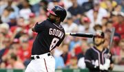 Washington Nationals' Bryce Harper, back right, watches as Brian Goodwin hits a solo home run during the first inning of a baseball against the Cincinnati Reds, Friday, June 23, 2017, in Washington. (AP Photo/Mark Tenally)