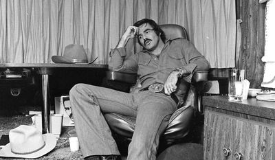 "FILE - In this Sept. 23,1976 file photo Burt Reynolds sits in his trailer on the set of ""Smokey and the Bandit,"" in Atlanta.   Hundreds of fans in Trans Ams made it to Atlanta to celebrate the 40th anniversary of ""Smokey and the Bandit."" About 350 cars retraced actor Burt Reynolds' wild ride from the Texas-Arkansas line to Atlanta in the movie that roared into pop culture in 1977. (Atlanta Journal-Constitution via AP)"