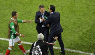 Mexico coach Juan Carlos Osorio, center, reacts during the Confederations Cup, Group A soccer match between Mexico and New Zealand, at the Fisht Stadium in Sochi, Russia, Wednesday, June 21, 2017. (AP Photo/Sergei Grits)