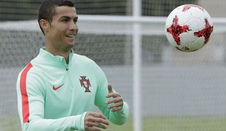 Portugal's Cristiano Ronaldo controls the ball, during a training session in St. Petersburg, Russia, Friday, June 23, 2017. Portugal will play New Zealand in a Confederations Cup, Group A soccer match scheduled for Saturday. (AP Photo/Dmitri Lovetsky)