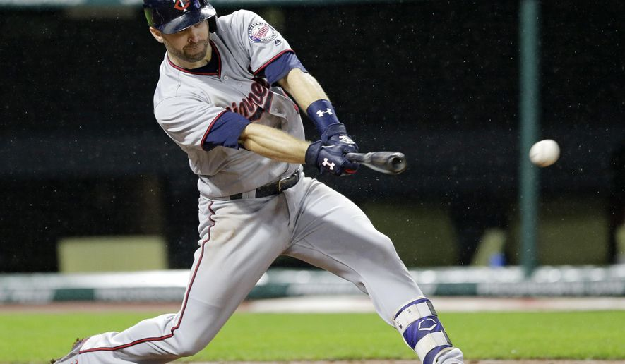 Minnesota Twins' Brian Dozier hits an RBI single off Cleveland Indians starting pitcher Trevor Bauer during the seventh inning of a baseball game, Friday, June 23, 2017, in Cleveland. (AP Photo/Tony Dejak)
