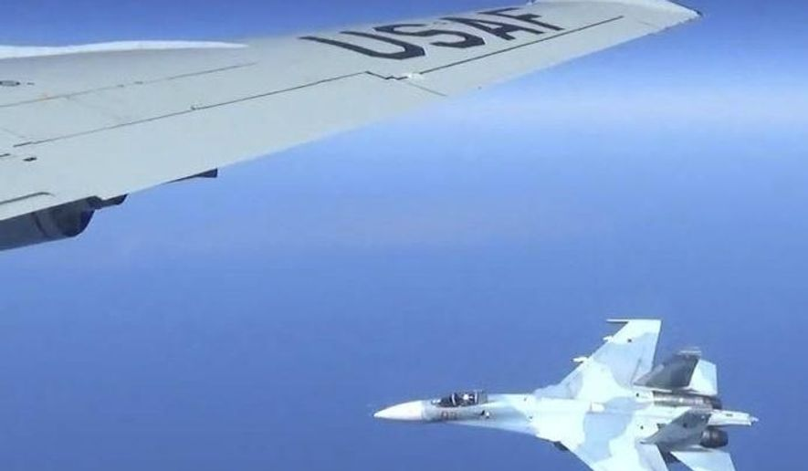 This is a  dramatic photo of a Russian jet coming within a few feet of a U.S. Air Force reconnaissance jet over the Baltic Sea, June 19, 2017, in a maneuver that has been criticized as unsafe. The photographs released Friday, June 23, 2017, show the Russian SU-27 coming so close to the wing of the U.S. RC-135U that the Russian pilot can be seen sitting in the cockpit in some images. (Master Sgt Charles Larkin Snr/U.S. European Command via AP) ** FILE **