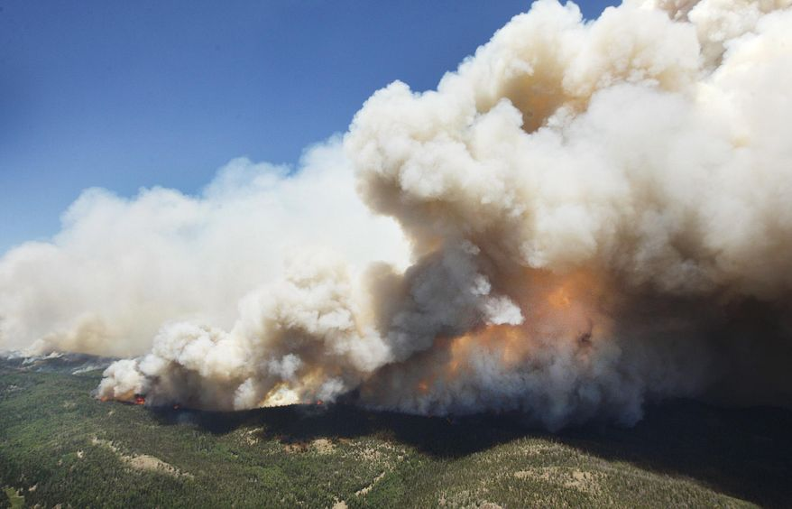 The Brian Head Fire continues to grow and has burned more than 27,700 acres, Friday, June 23, 2017 in Brian Head, Utah. A wildfire menacing a southern Utah ski town for nearly a week flared again, doubling in size for the second night in a row and torching more homes after residents fled the flames, officials said Friday. The blaze was one of several burning in the U.S. West as extreme heat challenges firefighters. (Stuart Johnson/The Deseret News via AP)