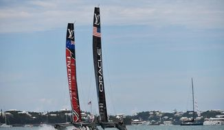 In this photo provided by America's Cup Event Authority, Emirates Team New Zealand competes against Oracle Team USA during the America's Cup sailing competition, in the Great Sound of Bermuda, Saturday, June 24, 2017. (Ricardo Pinto/ACEA via AP)