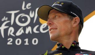 In this  July 25, 2010, file photo, Lance Armstrong, of the United States, looks back on the podium after the 20th and last stage of the Tour de France cycling race in Paris. (AP Photo/Bas Czerwinski, File)