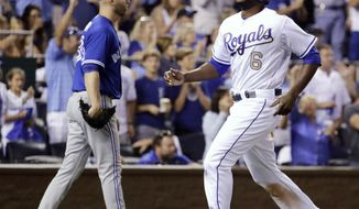 Kansas City Royals' Lorenzo Cain runs home to score on a single by Salvador Perez during the seventh inning of a baseball game against the Toronto Blue Jays on Friday, June 23, 2017, in Kansas City, Mo. (AP Photo/Charlie Riedel)