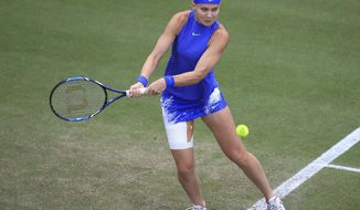 Czech Republic's Lucie Safarova in action against Czech Republic's Petra Kvitova  during their semifinal match at the Birmingham Classic tennis tournament at Edgbaston Priory, Birmingham, England. Saturday June 24, 2017. (Mike Egerton/PA via AP)