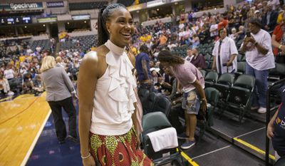Former Indiana Fever great Tamika Catchings smiles Saturday, June 24, 2017, while attending the Fever's WNBA basketball game against the Los Angeles Sparks in Indianapolis. The Fever are retiring her No. 24 jersey Saturday. (Robert Scheer/The Indianapolis Star via AP)