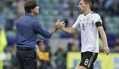 FILE - In this Monday, June 19, 2017 file photo, Germany coach Joachim Loew, LEFT, congratulates Leon Goretzka at the end of the Confederations Cup, Group B soccer match between Australia and Germany, at the Fisht Stadium in Sochi, Russia. Germany coach Joachim Loew says he has offered Leon Goretzka advice on his club future as the midfielder is linked with a move away from Schalke. (AP Photo/Thanassis Stavrakis, File)