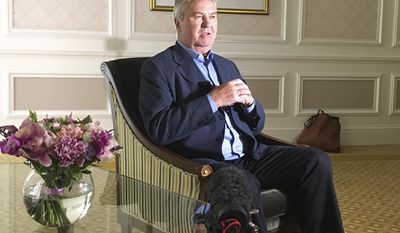 In this photo taken on Friday, June 23, 207, Guus Hiddink sits as he meets reporters in St. Petersburg, Russia. FIFA should pick the best referees for the World Cup and not limit its list to one per nation, according to coaching great Guus Hiddink. Hiddink, a two-time World Cup semifinalist, told The Associated Press three or four referees should be chosen from the same country if they were best at a job getting more complex with video review being tested. (AP Photo/Graham Dunbar)