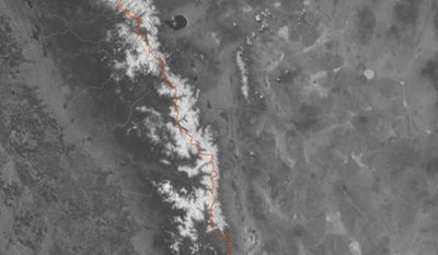 In this Sunday, June 4, 2017 satellite photo provided by the US National Weather Service that shows the Pacific Crest Trail in California's high Sierra drawn in red surrounded by snowpack. The dream trip of a lifetime has turned to nightmares for some hikers as a massive snowpack in the Sierra Nevada covers the trail and turns rivers to torrents. (US National Weather Service via AP)