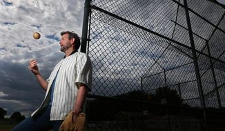 """Dwier Brown, author of the book, """"If You Build It...,"""" wears his John Kinsella jersey in North Canton, Ohio on June 8, 2017. The book is a memoir about fathers, fate and the movie """"Field of Dreams."""" (Phil Masturzo/Akron Beacon Journal via AP)"""