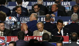 Representatives from NHL hockey teams begin their work during the second round of the NHL hockey draft, Saturday, June 24, 2017, in Chicago. (AP Photo/Nam Y. Huh)