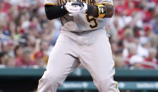 Pittsburgh Pirates' Josh Harrison celebrates as he arrives at home after hitting a solo home run during the fifth inning of the team's baseball game against the St. Louis Cardinals on Saturday, June 24, 2017, in St. Louis. (AP Photo/Jeff Roberson)
