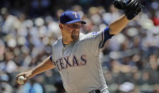 Texas Rangers' Austin Bibens-Dirkx delivers a pitch during the first inning of a baseball game against the New York Yankees Saturday, June 24, 2017, in New York. (AP Photo/Frank Franklin II)