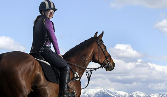This photo taken May 18, 2017, shows Suzy Buckmaster and her retired racehorse Zee, at Rebecca Farm in Kalispell, Montana. (Greg Lindstrom /Flathead Beacon via AP)
