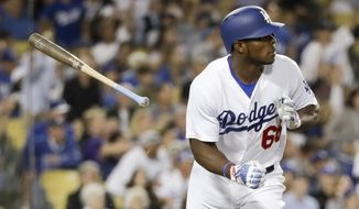 Los Angeles Dodgers' Yasiel Puig watches his home run against the Colorado Rockies during the fourth inning of a baseball game in Los Angeles, Friday, June 23, 2017. (AP Photo/Chris Carlson)