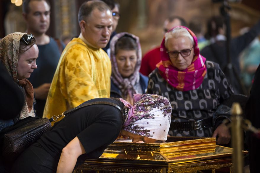 In this photo taken on Friday, May 26, 2017, Russian Orthodox believers line up to kiss the relics of Saint Nicholas that were brought from an Italian church where they have lain for 930 years, in the Christ the Savior Cathedral in Moscow, Russia. Over a million people have visited relics of Saint Nicholas, one of the Russian Orthodox Church's most revered figures, since they were brought to Moscow last month. (AP Photo/Alexander Zemlianichenko)