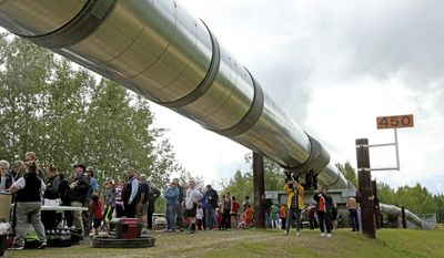 ADVANCE FOR WEEKEND JUNE 24-25, 2017 AND THEREAFTER - In this June 20, 2017 photo, people gather during the Alyeska Pipeline Service Company's 40th Anniversary celebration of the Trans Alaska Pipeline System at the pipeline viewpoint and visitors center in Fox, Alaska. More than 100 people gathered at the pipepine pullout in Fox to celebrate with root beer floats, gourmet hamburgers from Frostbite Foods and tacos from Tacos Al Pastor. (Eric Engman/Fairbanks Daily News-Miner via AP) /Fairbanks Daily News-Miner via AP)